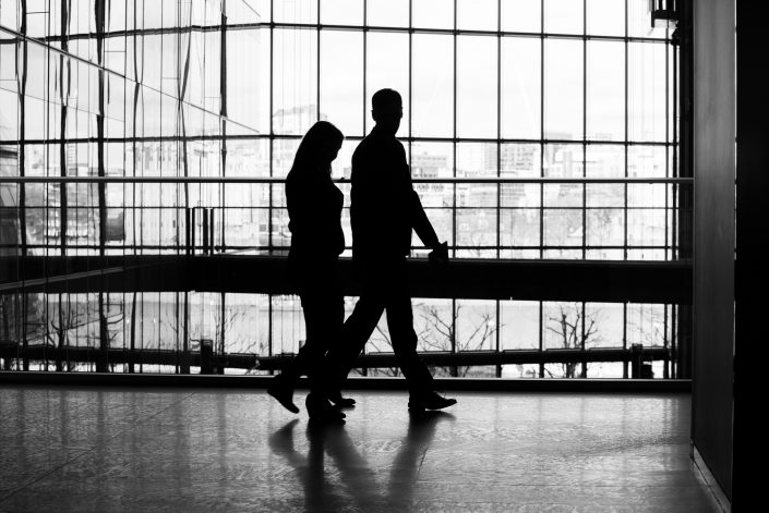 Silhouette image of corporate people walking